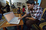 Mahmoud Omar Abdul Aziz, 16, an Iraqi refugee, works on his computer at home using skills he learned in a center for Iraqi refugees in Zarqa, Jordan. He hopes to use his training in website design to earn income. The center is supported by International Orthodox Christian Charities, a member of the ACT Alliance...