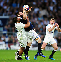 Cornell Du Preez of Scotland looks to offload the ball after being tackled by Billy Vunipola of England. RBS Six Nations match between England and Scotland on March 11, 2017 at Twickenham Stadium in London, England. Photo by: Patrick Khachfe / Onside Images