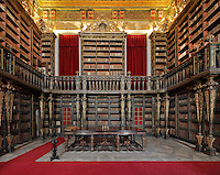 Green Room, with bookcases with Chinese motifs, lacquer and gilding by Manuel da Silva, in the Joanina Library, or Biblioteca Joanina, a Baroque library built 1717-28 by Gaspar Ferreira, part of the University of Coimbra General Library, in Coimbra, Portugal. The Casa da Livraria was built during the reign of King John V or Joao V, and consists of the Green Room, Red Room and Black Room, with 250,000 books dating from the 16th - 18th centuries. The library is part of the Faculty of Law and the University is housed in the buildings of the Royal Palace of Coimbra. The building is classified as a national monument and UNESCO World Heritage Site. Picture by Manuel Cohen