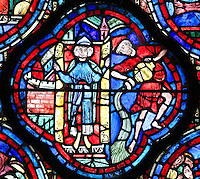 A 3-headed Janus representing past, present and future, opens the doors to a new year, and the figure of Aquarius pours water from a jug, section of January and Aquarius from the Zodiac and the labours of the months stained glass window, 1217, in the ambulatory of Chartres Cathedral, Eure-et-Loir, France. This calendar window contains scenes showing the zodiacal symbol with its corresponding monthly activity. Chartres cathedral was built 1194-1250 and is a fine example of Gothic architecture. Most of its windows date from 1205-40 although a few earlier 12th century examples are also intact. It was declared a UNESCO World Heritage Site in 1979. Picture by Manuel Cohen