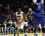 Ole Miss' Terrance Henry (1) vs. SMU's Shawn Williams (2) at the C.M. &quot;Tad&quot; Smith Coliseum in Oxford, Miss. on Tuesday, January 3, 2012. Ole Miss won 50-48.