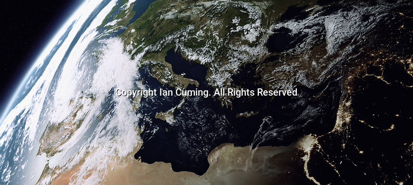 Digitally manipulated image of the Mediterranean Sea from space with day over Europe and night over the Middle East