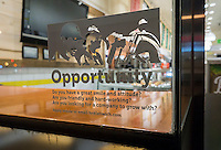 A sign in the window of a branch of the Lenwich sandwich shop chain in New York advises potential job applicants of the opportunities available, seen on Thursday, March 24, 2016.  (© Richard B. Levine)