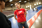 Kategory 5 talks to volunteers building the track for the bout between Hellcats and Putas del Fuego at Palmer Events Center in Austin, Texas.