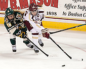 Bridget Baker (UVM - 16), Meagan Mangene (BC - 24) - The Boston College Eagles defeated the visiting University of Vermont Catamounts 2-0 on Saturday, January 18, 2014, at Kelley Rink in Conte Forum in Chestnut Hill, Massachusetts.