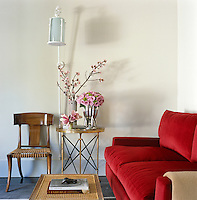 A corner of the living room with a red mohair sofa and one of eight Robsjohn-Gibbings' neo-classical Klismos chairs