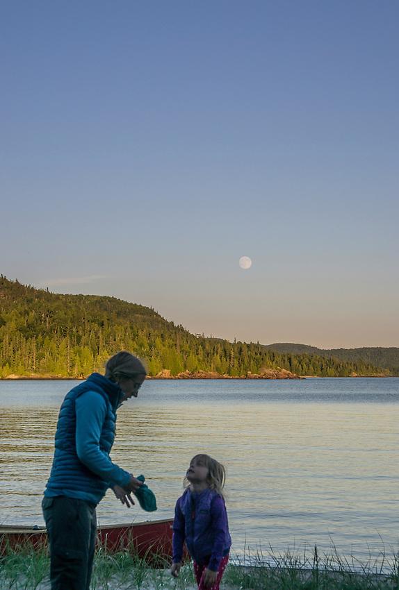 A full moon rises over Warp Bay while canoe camping at Lake Superior Provincial Park, Ontario, Canada.