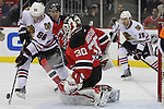 Mar 27; Newark, NJ, USA; Chicago Blackhawks right wing Patrick Kane (88) takes a shot on New Jersey Devils goalie Martin Brodeur (30) during the first period at the Prudential Center.