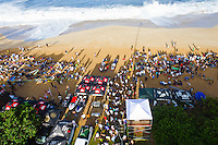 """Waimea Bay, Haleiwa, Oahu, Hawaii (Thursday January 20, 2011) .George Downing (HAW) , Contest Director of The Quiksilver In Memory of Eddie Aikau,has called a """"NO GO"""" for competition at Waimea Bay today, based upon the inconsistency of the swell. While there were definitely 20- to 25-foot waves sporadically throughout the morning, the consistency of those large waves was deemed to be insufficient to run the two rounds of competition. The event still has until February 28 to run...""""What we see in conditions like this is just one or two true 'Eddie' size waves in the period of a heat,"""" said Downing. """"With seven surfers in the water per heat, that is not the kind of playing field we need for quality, fair competition...""""It's very easy to get caught up in the excitement when those huge waves come through, and after all of the efforts of the crew and the spectators to get ready for this day. But what keeps this event the greatest big wave event in the world is never relaxing those standards. Eddie never did...""""We will continue to wait. The holding period runs through February 28 and we know that there is definite potential in the coming weeks for more extra large surf to arise. If that day comes, we will be ready to go again...The 15,000-strong crowd that had gathered under moonlight since the very early hours of the morning understood the call and settled in for the day, regardless. With the world's best big wave riders making the most of the opportunity to put some time in at Waimea, they will be treated to spectacular rides throughout the day, without question...2002 Eddie winner and 10X world champion Kelly Slater was in firm agreement with the decision: """"It's a good call."""" said Slater. """"There are big waves out there, but there's not that many of them. It's not what we need..Photo: joliphotos.com"""
