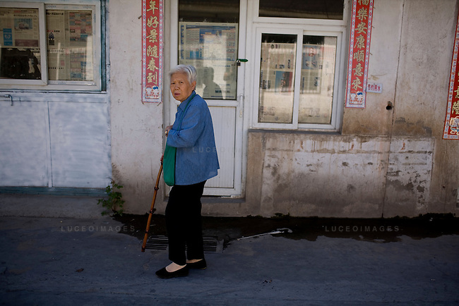 A woman walks to her home in a hutong in Beijing, China on Friday, August 22, 2008.  Kevin German