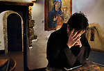 00634_04, 03/2010, Italy, ITALY-10033.  A priest prays with his hands on his face.<br /> <br /> Final Print_MACRO<br /> <br /> Retouched_Sonny Fabbri 03/08/2014