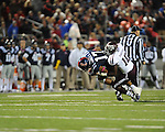Ole Miss tight end Jamal Mosley (17) is tackled by Texas A&M linebacker Sean Porter (10) at Vaught-Hemingway Stadium in Oxford, Miss. on Saturday, October 6, 2012. Texas A&M rallied from a 27-17 4th quarter deficit to win 30-27.