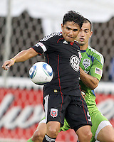 Jaime Moreno #99 of D.C. United backs into Patrick Ianni #4 of Seattle Sounders FC during an MLS match at RFK Stadium on July 15 2010, in Washington DC.Seattle won 1-0.