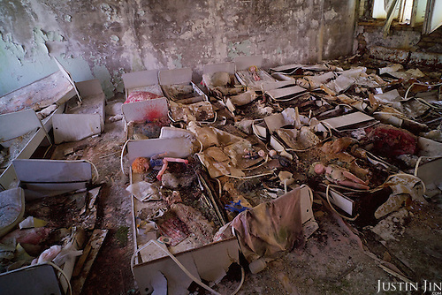 A kindergarten nursery room in Pripyat, a ghost town left deserted by the nuclear disaster in the Chernobyl power station nearby. All the wooden legs of the beds have decomposed. <br /> <br /> 30 years on, the city is still heavily contaminated, unfit for human life. <br /> <br /> The Chernobyl nuclear disaster happened on 26 April 1986.