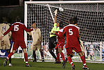 13 November 2009: Boston College's Justin Luthy (in green) is beaten for a goal on a shot by NC State's Ronnie Bouemboue (not pictured). The North Carolina State University Wolfpack defeated the Boston College Eagles 1-0 at WakeMed Stadium in Cary, North Carolina in an Atlantic Coast Conference Men's Soccer Tournament Semifinal game.
