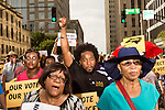July 13, 2015. Winston Salem, North Carolina.<br />  To rally support for the North Carolina NAACP's case against Gov. Pat McCrory (NC NAACP v. McCrory), a march was held in downtown Winston Salem on the opening day of the case in federal court. Thousands gathered to walk the streets of downtown and listen to speeches proclaiming the importance of defeating new requirements for voter registration,<br />  The NC NAACP contests that HB 589 (Voter ID requirements) violate Section 2 of the Voting Rights Act (42 U.S.C. 1973) and the Fourteenth and Fifteenth Amendments of the Constitution.