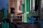 Blue bench outside house in Barentsburg, a Russian coal mining town in the Norwegian Archipelego of Svalbard. Once home to about 2000 miners and their families, less than 500 people now live here.