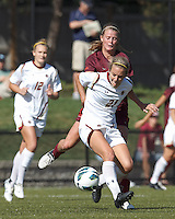Boston College midfielder Kate McCarthy (21) dribbles as Virginia Tech midfielder Ashley Meier (15) pressures.Virginia Tech (maroon) defeated Boston College (white), 1-0, at Newton Soccer Field, on September 22, 2013.