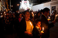 People take part in a procession through the streets of Ayacucho, Peru, on Tuesday during Holy Week.