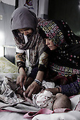 Kabul, Afghanistan<br /> November 29, 2001<br /> <br /> Indira Ghandi children's hospital.<br /> <br /> A child is given anti-infection shots each day in the malnutrition ward.