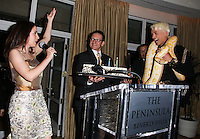 BEVERLY HILLS, CA, USA - MARCH 28: Christina DeRosa, KUBA Ka at the Versace Unveiling Of The 1st Pop Recording Artist Superhero - KUBA Ka's Performance Outfits. Designed by the legendary fashion hosuse - Donatella Versace. For the Benefit of the Face Forward Foundation (Plastic Surgery for Destroyed Faces from Violence). Pop entertainer TV personality KUBA Ka, together with VERSACE, unveiled Kuba Ka's new Versace images, for the First Pop Artist/Superhero of the World. He has become the inspiration of Donatella's newest and wildest creations and will celebrate the launch of his new power house conglomerate - KUBA Ka Empire Inc. in collaboration with the sensational fashion house - VERSACE on Friday, his birthday at a red carpet media and celebrity event at the luxurious Peninsula Hotel in Beverly Hills held at the Peninsula Hotel on March 28, 2014 in Beverly Hills, California, United States. (Photo by Xavier Collin/Celebrity Monitor)