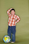 Young boy scratching his head with a globe at his feet - Model Reese, MUA Lauren Rennells.