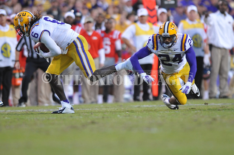 LSU safety Craig Loston (6) intercepts against Ole Miss in front of teammate LSU cornerback Tharold Simon (24) at Tiger Stadium in Baton Rouge, La. on Saturday, November 17, 2012. LSU won 41-35.....