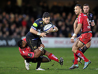 Horacio Agulla of Bath Rugby is tackled by Steffon Armitage of Toulon. European Rugby Champions Cup match, between Bath Rugby and RC Toulon on January 23, 2016 at the Recreation Ground in Bath, England. Photo by: Patrick Khachfe / Onside Images