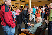 Vice President Joe Biden greets staff and volunteers during an unscheduled stop at a campaign field office while on a two-day campaign swing through Iowa on Monday, September 17, 2012 in Ottumwa, IA.