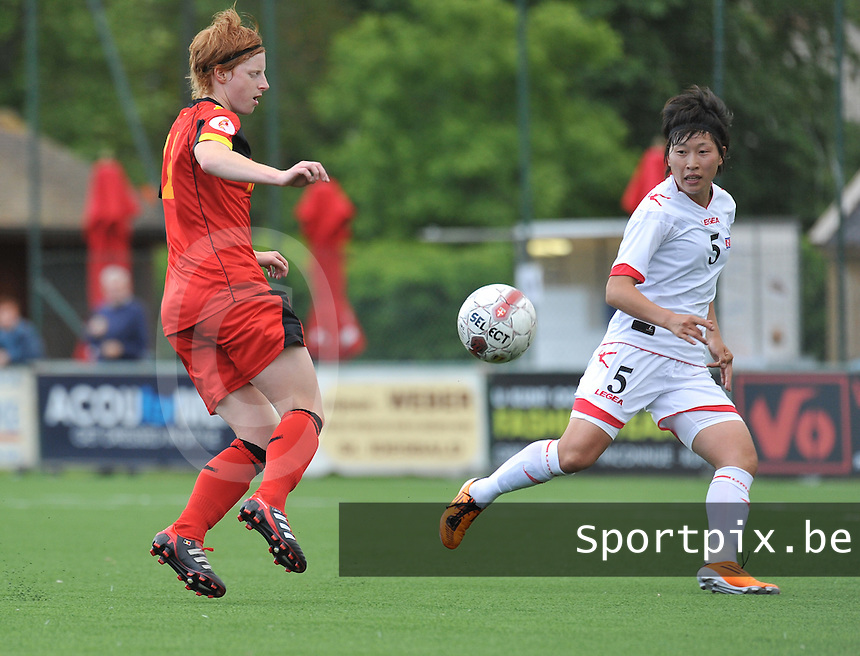 Belgium A - North Korea friendly game at Koksijde KVV Stadium - Belgie - Noord Korea : Lien Mermans aan de bal voor 5. Yun Song Mi.foto David Catry / Joke Vuylsteke / Vrouwenteam.be