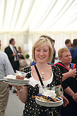 After the graduation ceremony, catering staff work hard in the marquee, University of Surrey.