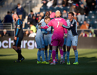 Jimmy Nielsen (1) of Sporting Kansas City celebrates the win with Matt Besler (5) and other teammates after a Major League Soccer game at PPL Park in Chester, PA. Sporting Kansas City defeated the Philadelphia Union, 2-1.