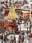 Busy shoppers blurred with motion at Toronto Eaton Centre shopping mall on Boxing day in 2011. Toronto, Ontario, Canada.
