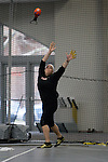 11 MAR 2011: Mindy Harrington of Carthage College throws during the the Division III Men's and Women's Indoor Track and Field Championships held at the Capital Center Fieldhouse on the Capital University campus in Columbus, OH.  Carthage finished third in the event with a throw of 18.14 meters (59'6.25&quot;). Jay LaPrete/NCAA Photos
