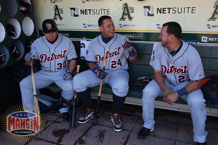 OAKLAND, CA - SEPTEMBER 17:  Magglio Ordonez #30, Miguel Cabrera #24 and Jhonny Peralta #27 of the Detroit Tigers get ready in the dugout before the game against the Oakland Athletics at O.co Coliseum on September 17, 2011 in Oakland, California. Photo by Brad Mangin