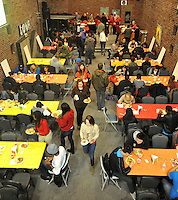 NWA Democrat-Gazette/MICHAEL WOODS &bull; @NWAMICHAELW<br /> University of Arkansas students fill up the hall to eat Tuesday, November 17, 2015 during the 34th annual Thanksgiving dinner for UA students at the Rock House in Fayetteville.  The event hosted by Christ on Campus, a non-denominational ministry on the UA campus, feeds around 300 university students.  It is a cooperative effort with Christ on Campus and several local churches including Community Christian Church in Fayetteville and Rogers Christian Church.