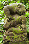 Monkey Forest, Ubud, Bali, Indonesia; a lizard statue within the sanctuary