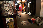 Man sleeping on the street at 4 am in Goldengai, a nightlife area with some of the oldest bars in Tokyo.
