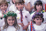 Castleton Garland Day Castleton Derbyshire UK May 29th. Schoolchildren taking party in parade. Flowers in hair.
