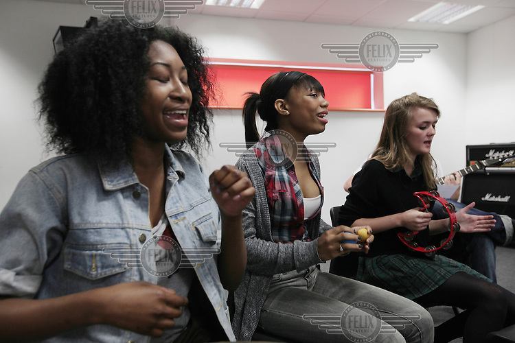 Students sing and play music in the music studios at the Brit School, in Croydon. The Brit is Britain's only non-fee paying performing arts and technology school.