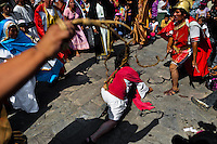 A group of Peruvian actors perform flagellation of Jesus Christ in the Good Friday procession during the Holy week in Lima, Peru, 30 March 2013. The annual Passion Of Christ procession, held as part of Easter celebrations, starts in Lima downtown and, followed by thousands of catholic believers, it climbs to the top of the dry and rocky hill of San Cristobal, where Mario Valencia, who has been playing the role of Jesus Christ for more than 30 years, is symbolically crucified.