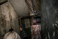 June 09, 2015 - Beirut, Lebanon: Ammal Akkar (right bottom) a Palestinian refugee born in Tel-Al Zataar camp in East Beirut, walks through passageways to her house in Shatila refugee camp. (Photo/Narciso Contreras)