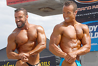 Bodybuilders pose-off during the the Muscle Beach Bodybuilding championship at Venice Beach on Monday, September 5, 2011.