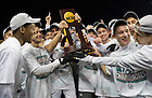 Dec 15, 2013; The Notre Dame men's soccer team celebrates with the College Cup championship trophy after defeating Maryland 2-1 in Chester, Pa. Photo by Barbara Johnston/University Photographer