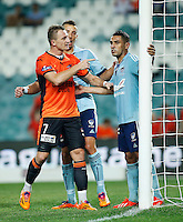 Brisbane Roar Besart Berisha (L) and Sydney FC Ali Abbas during their A-League match in Sydney, March 14, 2014. Photo by Daniel Munoz/VIEWPRESS EDITORIAL USE ONLY