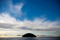 Ailsa Craig, an unihabited volcanic island that is the source of the granite used to make most of the world's curling stones, including those used every four years in the Winter Olympics. The island is for sale with an asking price of GBP 1.6 million.