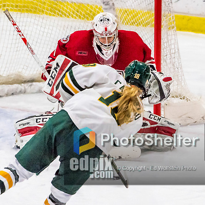 25 November 2016: University of Vermont Catamount Forward Cassidy Campeau (18), a Senior from Nepean, Ontario, moves in on Saint Cloud State Huskie Goaltender Janine Alder, a Freshman from Zurich, Switzerland, at Gutterson Fieldhouse in Burlington, Vermont. The Lady Cats defeated the Huskies 5-1 to take the first game of the 2016 Windjammer Classic Tournament. Mandatory Credit: Ed Wolfstein Photo *** RAW (NEF) Image File Available ***