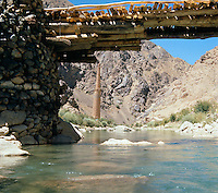 The Jam bridge build by the Italian architect Andrea Bruno under UNESCO mission in 1976. In the back of the bridge, the Menar e Jam, Ghor province  Afghanistan..Next to the Menar e Jam, the former capital of the Ghorides Empire Fîrûzkôh.