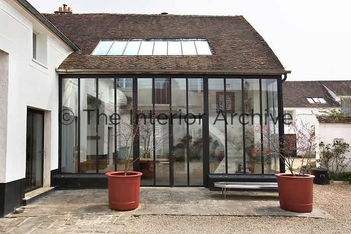 Although the conservatory was added by the present owner it was designed to blend seamlessly with the original farmhouse