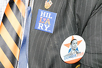 A California delegate wears Hillary and Obama buttons on the final day of the Democratic National Convention at the Wells Fargo Center in Philadelphia, Pennsylvania, on Thurs., July 28, 2016.